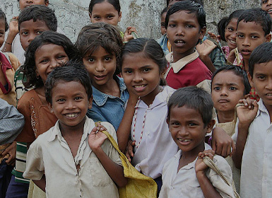 A group of children smiling at the camera