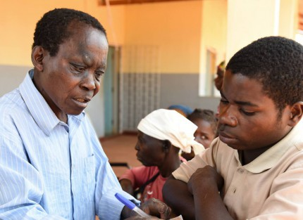 A doctor talking with a young man