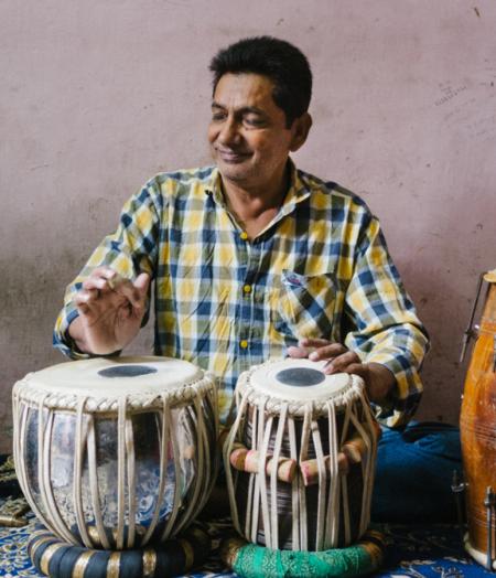 Muneer plays his Tabla drums.