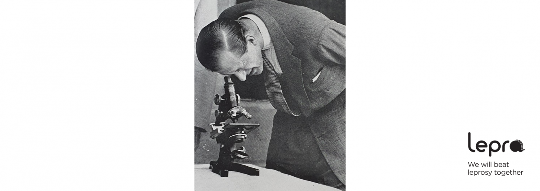 Prince Philip looking through microscope in Nigeria