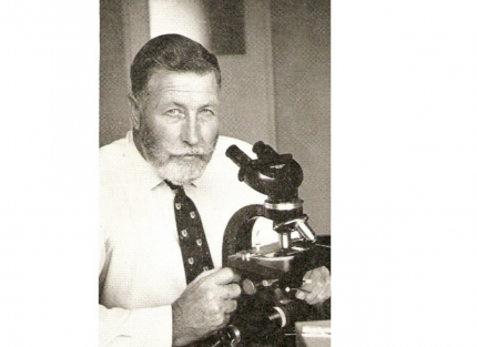 Dr Molesworth with his microscope
