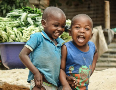 Two boys laughing at the camera