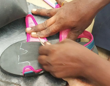 Some shoes being made