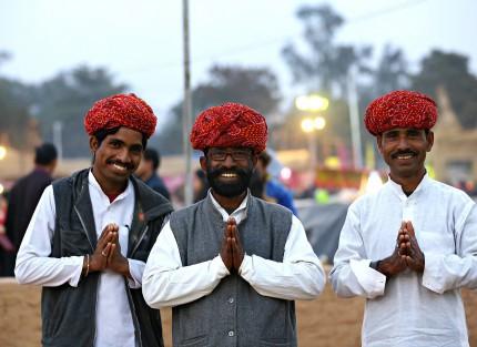 Three men with prayer hands