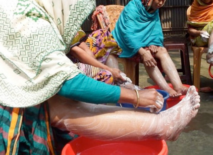 A woman washing her feet - part of the Mental Motivators programme
