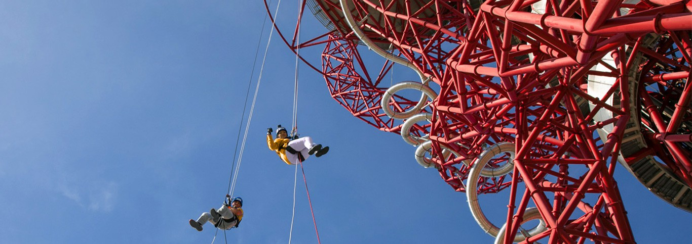 People abseiling from the Orbit