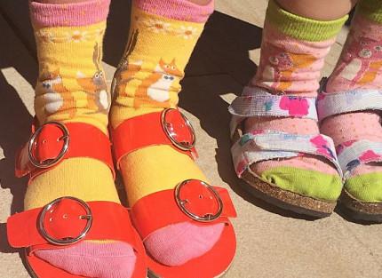 Children wearing socks and sandals