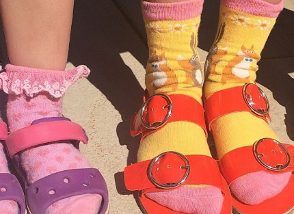 Children wearing socks and sandals to raise money